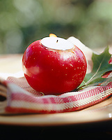 An apple with a tealight in it makes a striking decoration as a place setting
