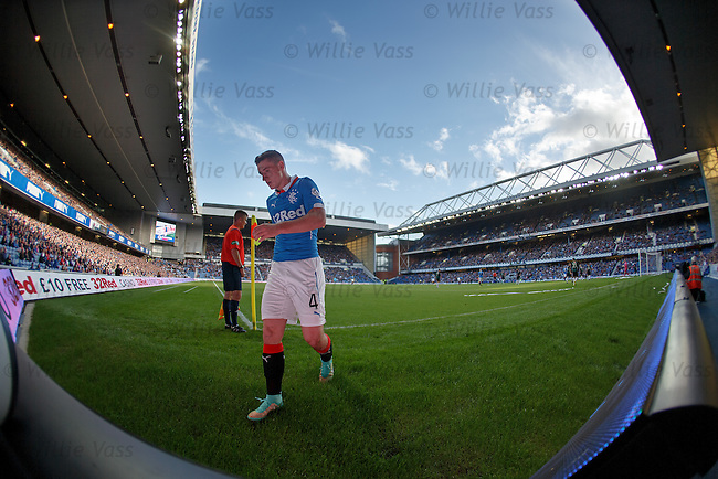 Fraser Aird towers over Ibrox as he prepares to take a corner kick