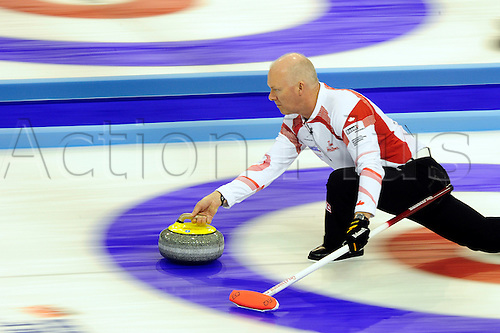 02.04.2012 Basel, Switzerland. Canada skip Glenn Howard in action during day three of the Mens World Curling Championships from St Jakobshalle.