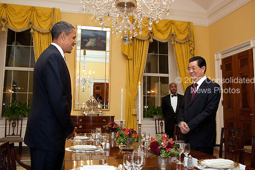 United States President Barack Obama and President Hu Jintao of China begin their working dinner in the Old Family Dining Room of the White House, Tuesday, January 18, 2011. .Mandatory Credit: Pete Souza - White House via CNP