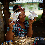 Tongan lady showing shells, Tonga, South Pacific, 1980.