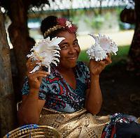 Tongan lady showing shells, Tonga, South Pacific, 1980.