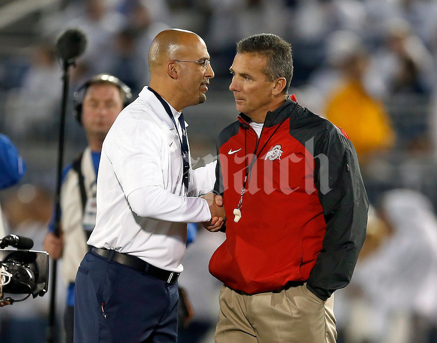 Penn State Nittany Lions head coach James Franklin shakes hands with Ohio State Buckeyes head coach Urban Meyer before Saturday's NCAA Division I football game at Beaver Stadium in University Park, PA on October 25, 2014. (Columbus Dispatch photo by Jonathan Quilter)
