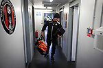 A visiting member of the backroom staff arriving at the away dressing room before Gala Fairydean Rovers host Gretna 2008 in a Scottish Lowland League match at Netherdale, Galashiels. The home club were established in 2013 through a merger of Gala Fairydean, one of Scotland's most successful non-League clubs, and local amateur club Gala Rovers. The visitors were a 'phoenix' club set up in the wake of the collapse of the original club, which had competed for a short time in the 2000s before going bankrupt. The home aside won this encounter 4-1 watched by a crowd of 120 at a stadium which features one of the country's most notable stands, a listed building constructed in 1964 but at the time of this fixture closed to spectators on safety grounds.