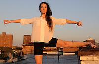 Gregory Holmgren Photographer, NYC dance, movement project with model, dancer Allison Jones at The ClockTower Rooftop, Bronx, New York, New York, September 12, 2012.