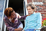 Karen Morris has been caring for her mother Gloria, 80, for the past 10 years. Her mother has Alzheimer's disease and lives with Karen and Karen's husband Richard in their Charlotte, NC home. The pair take in the morning sunshine on the front porch. ..Mrs. Morris was a nurse before she retired and really enjoys taking care of people, she said. Every morning she washes her mother in the bathroom, helps her walk down the stairs, and they share breakfast, as they did Monday, October 18, 2010...Gloria was having an especially bad day and because Karen sees her every day, she knew something was wrong. She later discovered her medication was dehydrating her. That is one of many reasons why having a regular caretaker is so important. ...Kendrick Brinson.LUCEO.Model Released: Yes.AARP Contract #4859.Wichita/Bellovin Bulletin..
