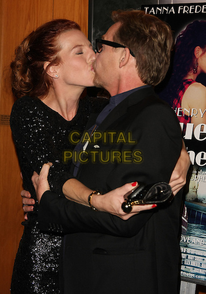 "DENNIS CHRISTOPHER.Henry Jaglom's ""Queen Of The Lot"" Los Angeles Premiere held at the Directors Guild of America, West Hollywood, CA, USA..November 18th, 2010.half length black dress sparkly hug embrace kiss kissing funny clutch bag suit jacket.CAP/ADM/TB.©Tommaso Boddi/AdMedia/Capital Pictures."