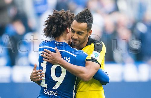 10.04.2016. Gelsenkirchen, Germany.  Schalke's Leroy Sane (L) embraces Dortmund's Pierre-Emerick Aubameyang after the German Bundesliga  match between FCSchalke 04 and Borussia Dortmund at the Veltins Arena in Gelsenkirchen, Germany, 10 April 2016.