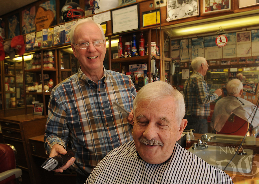 NWA Democrat-Gazette/FLIP PUTTHOFF<br /> Gary Townzen gives a haircut to John Yount Thursday Dec. 17, 2015 at his barbershop in Rogers. Donations offered Saturday during Townzen's free haircut day go to buy food for area families through the Samaritan Community Center.