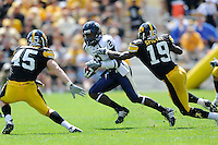 6 September 2008:  FIU wide receiver Junior Mertile (2) attempts to evade Iowa defensive back Amari Spievey (19) and linebacker Tyler Nielsen (45) in the second half of the Iowa 42-0 victory over FIU at Kinnick Field in Iowa City, Iowa.