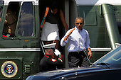 United States President Barack Obama, center, returns a salute to a U.S. Marine, left, as he and daughter Malia Obama, 16, step out of Marine One after arriving at the Martha's Vineyard Airport in West Tisbury, Massachusetts, U.S., on Saturday, August 9, 2014.  The Obama's are vacationing on the island for two weeks.<br /> Credit: Matthew Healey / Pool via CNP