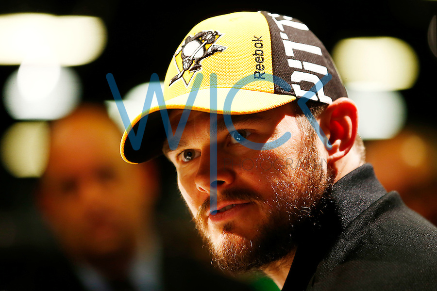 Chris Kunitz #14 of the Pittsburgh Penguins speaks during media day prior to the start of the Stanley Cup Final series between the Pittsburgh Penguins and the San Jose Sharks at Consol Energy Center in Pittsburgh, Pennslyvania on May 29, 2016. (Photo by Jared Wickerham / DKPS)