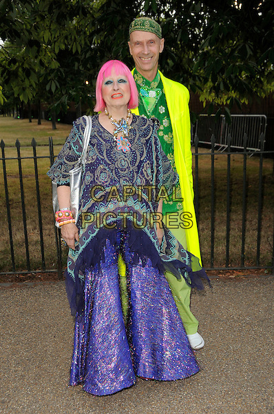 ZANDRA RHODES & ANDREW LOGAN.The Summer Party at The Serpentine Gallery, London, England. .July 9th, 2009 .full length purple dress long maxi pattern green couple pink hair .CAP/CAS.©Bob Cass/Capital Pictures.