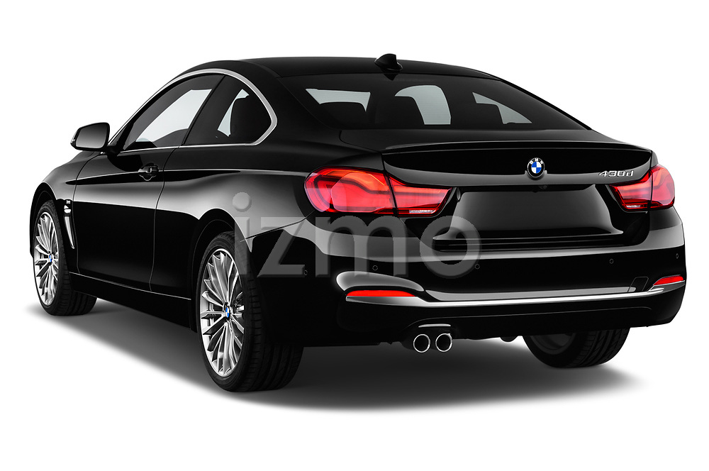 Car pictures of rear three quarter view of a 2018 BMW 4 Series Luxury 4 Door Coupe angular rear