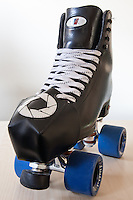 My new custom toe guards (toe protectors) on my Riedell 120 black roller skating boots with Sure Grip Fugitive wheels.  The Toe Guards were made by Derby Vixen (http://www.etsy.com/shop/derbyvixen), and are AWESOME.  The pattern is a camera lens diaphragm, which is perfect for my derby name.