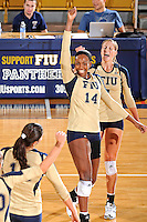 11 September 2011:  FIU setter Renele Forde (14) and outside hitter Una Trkulja (7) celebrate winning a key point in the second set as the FIU Golden Panthers defeated the Florida A&M University Rattlers, 3-0 (25-10, 25-23, 26-24), at U.S Century Bank Arena in Miami, Florida.