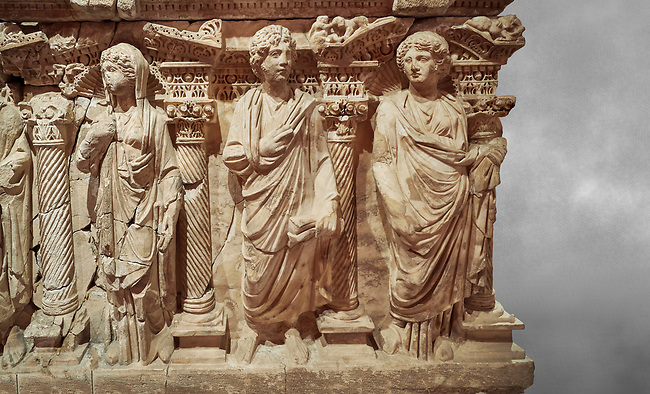 """Roman relief sculpted sarcophagus of Domitias Julianus and Domita Philiska, 2nd century AD, Perge. Antalya Archaeology Museum, Turkey.<br /> <br /> <br /> it is from the group of tombs classified as. """"Columned Sarcophagi of Asia Minor"""". <br /> The lid of the sarcophagus is sculpted into the form of a """"Kline"""" style Roman couch on which lie Julianus &  Philiska. This type of Sarcophagus is also known as a Sydemara Type of Tomb."""