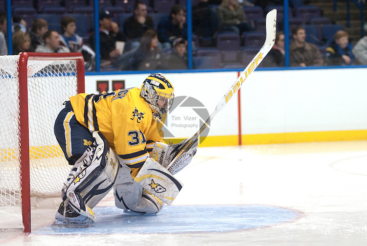 March 26,  2011                     Michigan goalie Shawn Hunwick (31) hits the ice with his stick in the second period. The University of Michigan beat Colorado College 2-1 in the championship game of the NCAA Division 1 Men's West Regional Hockey Tournament, on Saturday March 26, 2011 at the Scottrade Center in downtown St. Louis.