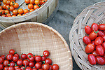 Three varieties of cherry tomatoes for sale at farmers market