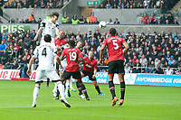 Saturday 17 August 2013<br /> <br /> Pictured: Muchu ( in the air ) Makes an attempt at goal<br /> <br /> Re: Barclays Premier League Swansea City v Manchester United at the Liberty Stadium, Swansea, Wales