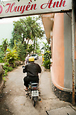 VIETNAM, Hue, Huyen Anh restaurant, patrons leave the restaurant on mopeds while another car full drives in for lunch