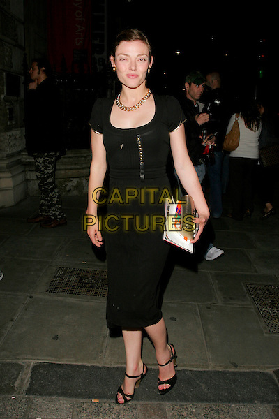 CAMILLA RUTHERFORD .Leaving The Royal Academy of Arts Summer Exhibition 2008 preview party at Royal Academy of Arts in London, England..June 4th, 2008.full length black dress sandals gold necklace buttons.CAP/AH.©Adam Houghton/Capital Pictures.
