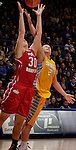 SIOUX FALLS, SD - MARCH 12:  Margaret McCloud #30 of the University of South Dakota and Leah Dietel #21 of South Dakota State battle for a rebound during their championship game at the 2013 Summit League Tournament at the Sioux Falls Arena Tuesday. (Photo by Dick Carlson/Inertia)