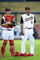 Quad Cities River Bandits pitcher Ricky Martinez #19 and catcher Adam Lewis #29 during a game against the Cedar Rapids Kernels at Modern Woodmen Park on June 30, 2012 in Davenport, Illinois.  Quad Cities defeated Davenport 8-7.  (Mike Janes/Four Seam Images)