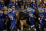 Joker Phillips running onto the field before the first half of the UK Football game v. Samford at Commonwealth Stadium in Lexington, Ky., on Saturday, November 17, 2012. Photo by Genevieve Adams | Staff