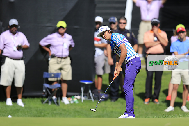 Rickie Fowler (USA) putts on the 16th green during Saturday's Round 3 of the 2013 Bridgestone Invitational WGC tournament held at the Firestone Country Club, Akron, Ohio. 3rd August 2013.<br /> Picture: Eoin Clarke www.golffile.ie