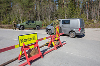 Norwegian authorites introduced strict measures to combat the Coronavirus (COVID-19) in March 2020. This included closing the borders, and any Norwegians returning from abroad is given two weeks quarantine. <br /> <br /> Police and soldiers from the Home Guard of the Army (Heimevernet) man checkpoints along side roads and regular border crossings to enforce the travel restrictions.<br /> <br /> <br /> <br /> ©Fredrik Naumann/Felix Features