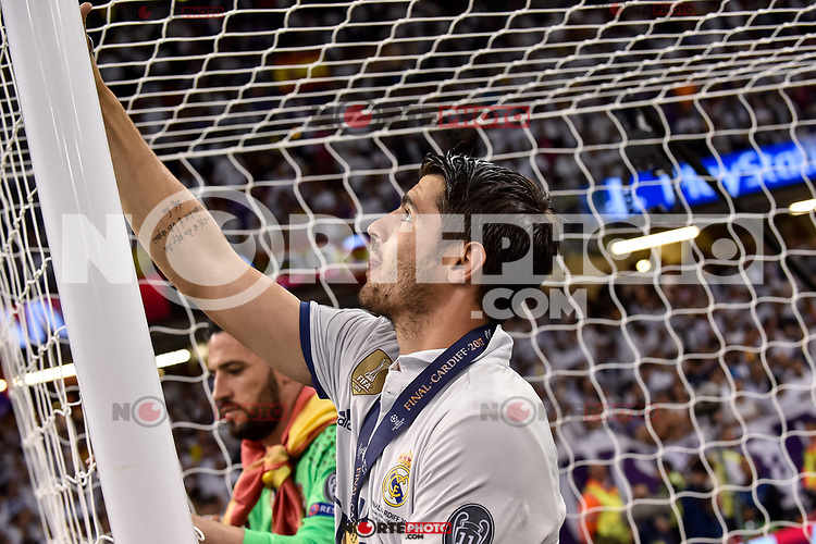 Alvaro Morata of Real Madrid cuts the net to take a souvenir during the UEFA Champions League Final match between Real Madrid and Juventus at the National Stadium of Wales, Cardiff, Wales on 3 June 2017. Photo by Giuseppe Maffia.<br /> <br /> Giuseppe Maffia/UK Sports Pics Ltd/Alterphotos /nortephoto.com