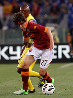 Calcio, Serie A: Roma vs Chievo Verona. Roma, stadio Olimpico, 7 maggio 2013..AS Roma defender Dodo', of Brazil, is challenged by ChievoVerona midfielder Luciano, also of Brazil, partially hidden, during the Italian Serie A football match between AS Roma and ChievoVerona at Rome's Olympic stadium, 7 May 2013..UPDATE IMAGES PRESS/Riccardo De Luca