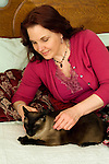 Mature woman playing with her pet