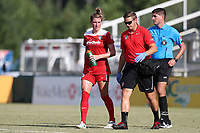 Cary, North Carolina  - Saturday August 19, 2017: Cheyna Williams is helped off of the field by trainer Pierre Soubrier during a regular season National Women's Soccer League (NWSL) match between the North Carolina Courage and the Washington Spirit at Sahlen's Stadium at WakeMed Soccer Park. North Carolina won the game 2-0.