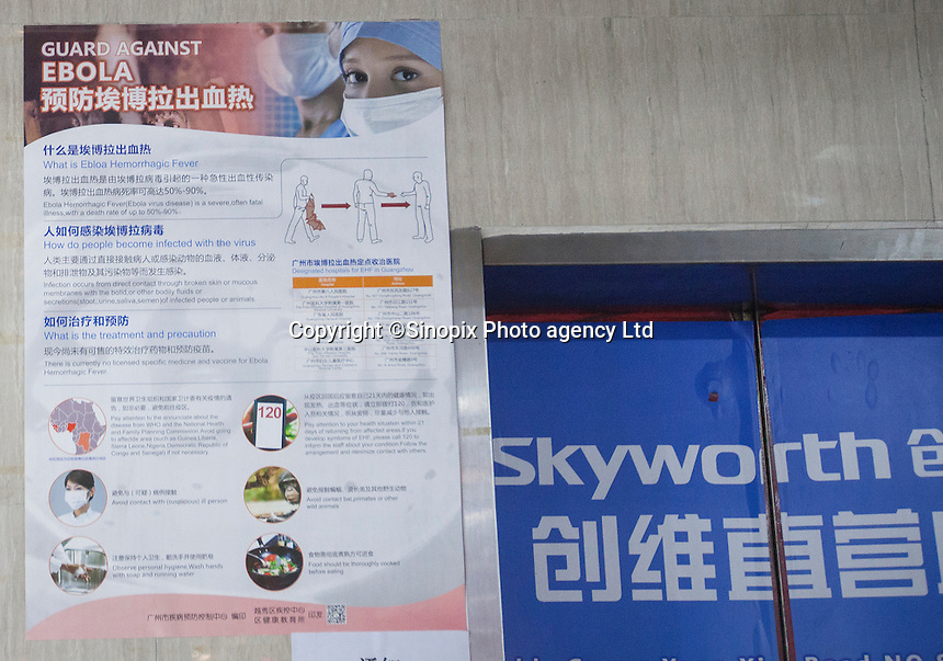 A poster put up by the Guangzhou health authorities to raise awarenss about ways to prevent an outbreak of the ebola virus disease is seen by an elevator used by African and Chinese people in an area of Guangzhou known to locals as 'Chocolate City', Guangzhou, Guangdong Province, China, 08 December 2014. The health authorities of Guangzhou are said to be stepping up their monitoring of the African community in light of the ongoing outbreak of the Ebola virus disease in West Africa.