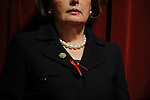 Cherilyn Murer, Chairman. of the Board of Trustees, wears a red and black ribbon, the school's colors, at a press conference following a deadly school shooting at Northern Illinois University in DeKalb, Illinois on February 15, 2008.  Stephen Kazmierczak, 27, opened fire at Cole Hall in the university on February 14 killing five students and wounding 15 others before turning his gun on himself, police said.