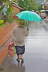 Woman In Early Morning Rain