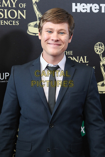 BEVERLY HILLS, CA - JUNE 22: Guy Wilson attending The 41st Annual Daytime Emmy Awards held at The Beverly Hilton Hotel in Beverly Hills, California on June 22nd, 2014. <br /> CAP/MPI/RTNUPA<br /> &copy;RTNUPA/MPI/Capital Pictures