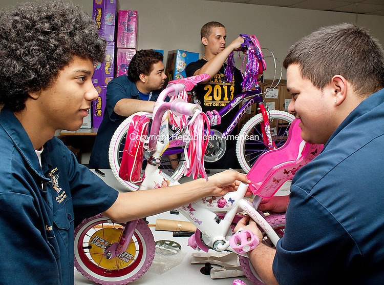 WATERBURY CT- DECEMBER 05 2012 -120612DA01-Kaynor Technical High School Auto Tech student, from left, Brandon Moher, Branden Soto, Brandon Martinez, Mark McCann along with other classmates use their tools and skills to put together 100 bikes that were given from an anonymous donor for the Connecticut Association of Foster & Adoptive Parents in Waterbury on Wwednesday..Darlene Douty Republican American