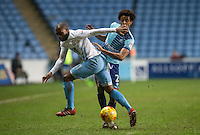 Kyel Reid of Coventry City & Sido Jombati of Wycombe Wanderers during the The Checkatrade Trophy - EFL Trophy Semi Final match between Coventry City and Wycombe Wanderers at the Ricoh Arena, Coventry, England on 7 February 2017. Photo by Andy Rowland.
