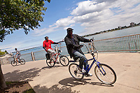 Cyclists ride on Detroit riverWalk Saturday June 8, 2013.  River Walk is a 9km promenade from the Ambassador Bridge to Belle Isle.