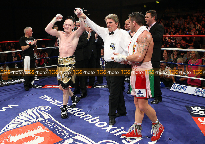 Matthew Hatton (gold/black shorts) defeats Gianluca Branco for the European (EBU) Welterwight title at Goresbrook Leisure Centre, Dagenham promoted by Ricky Hatton -  27/03/10 - MANDATORY CREDIT: Gavin Ellis/TGSPHOTO - Self billing applies where appropriate - Tel: 0845 094 6026