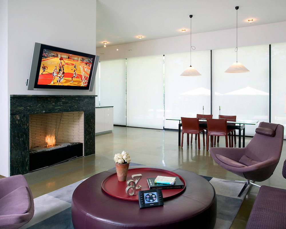 Open Room With TV Over Fireplace