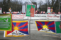 "Switzerland. Basel. Oustide the St. Jakobshalle. A group of Doegyal / Shugden followers are protesting against the existence of His Holiness the Dalai Lama and write on a banner to stop lying. The pro Dalai Lama followers show tibetan flags and a poster with the words "" We stand with His Holiness the Dalai Lama. The 14th and current Dalai Lama is Tenzin Gyatso, recognized since 1950. He is the current Dalai Lama, as well as the longest-lived incumbent, well known for his lifelong advocacy for Tibetans inside and outside Tibet. Dalai Lamas are amongst the head monks of the Gelug school, the newest of the schools of Tibetan Buddhism. The Dalai Lama, also called "" Ocean of Wisdom"" is considered as the incarnation of Chenresi, the Bodhisattva of compassion who is also the protective deity of Tibet. The Tibetan flag, also known as the ""snow lion flag"" and the 'Free Tibet flag', was a flag of the military of Tibet, introduced by the 13th Dalai Lama in 1912 and used for the same capacity until 1959. Designed with the help of a Japanese priest, it reflects the design motif of the Japanese military's Rising Sun Flag. Since the 1960s, it is used a symbol of the Tibetan independence movement. 8.02.2015 © 2015 Didier Ruef"