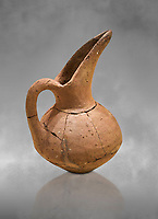 Hittite terra cotta beak spout pitcher . Hittite Period, 1600 - 1200 BC.  Hattusa Boğazkale. Çorum Archaeological Museum, Corum, Turkey. Against a grey bacground.