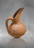 Hittite terra cotta beak spout pitcher . Hittite Period, 1600 - 1200 BC.  Hattusa Boğazkale. Çorum Archaeological Museum, Corum, Turkey. Against a grey bacground.