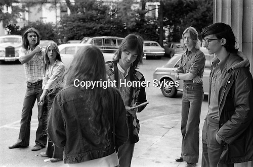 "Jimmy signing autographs outside Southampton Hotel 1975 Wings Tour UK. Linda daughter and tutor behind left. McCartney two Rolls Royce parked in hotel car park. The photographs from this set were taken in 1975. I was on tour with them for a children's ""Fact Book"". This book was called, The Facts about a Pop Group Featuring Wings. Introduced by Paul McCartney, published by G.Whizzard. They had recently recorded albums, Wildlife, Red Rose Speedway, Band on the Run and Venus and Mars. I believe it was the English leg of Wings Over the World tour. But as I recall they were promoting,  Band on the Run and Venus and Mars in particular."
