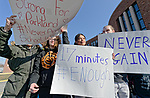 North Bellmore; New York; USA. March 14; 2018. Protesting gun violence, Mepham High School students walk out of class for 17 minutes; from 10:00 am to 10:17 am EST; one minute for each student shot and killed last month in a Parkland, Florida, H.S. Protest signs messages are: NEVER AGAIN, 17 minutes, Strong For Parkland, School Walkout, and have hashtags: #ENOUGH, #NeverAgain. It was part of a nationwide walkout in soildarity with student shooting victims, and a demand for U.S. laws to reduce gun violence.