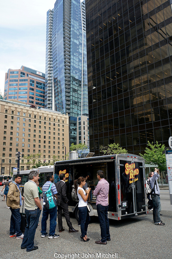 People ordering lunch from a food truck in downtown Vancouver, BC, Canada